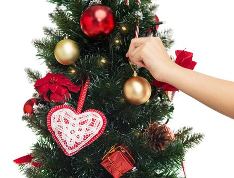 winter holidays, celebration and people concept - close up of woman decorating christmas tree with ball