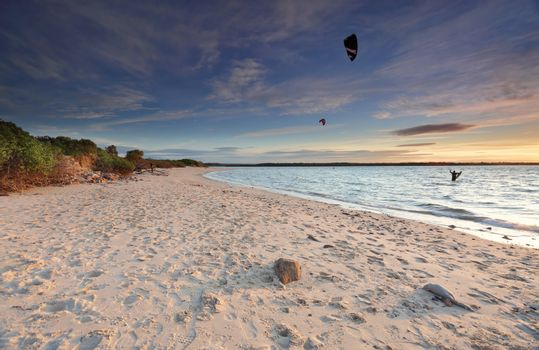 Kite Surfers at sunset on Silver Beach, Botany Bay Australia