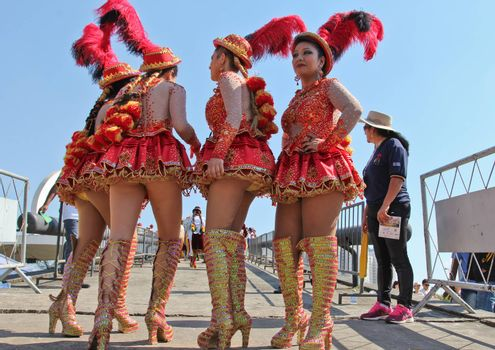 SAO PAULO, BRAZIL August 9 2015: An unidentified group of girls with typical costumes wait for the Morenada parade in Bolivian Independence Day celebration in Sao Paulo Brazil.
