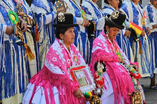 SAO PAULO, BRAZIL August 9 2015: An unidentified group of women with typical costumes wait for the Morenada parade in Bolivian Independence Day celebration in Sao Paulo Brazil.