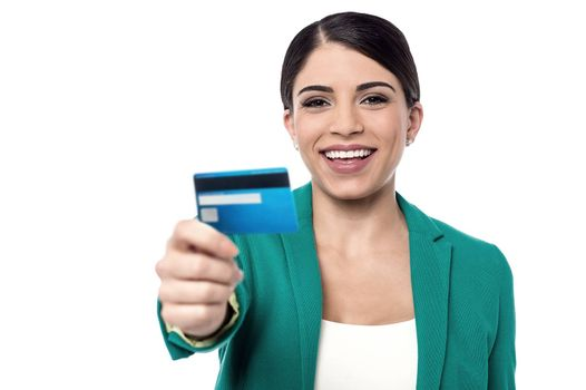 Female executive showing a cash card to camera