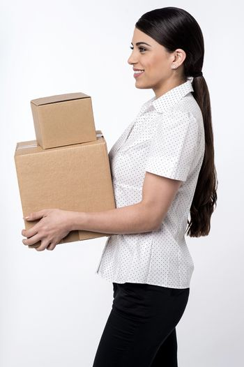 Image of a woman carrying stack of carton boxes