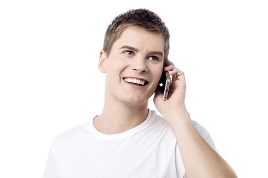 Young handsome man talking on cell phone