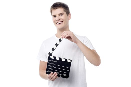 Cheerful young male with open film slate