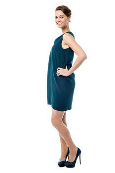 Side pose of pretty woman in trendy wear