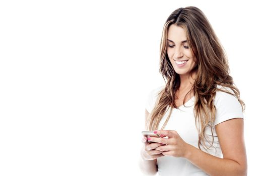 Cheerful woman messaging via her phone