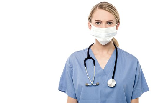 Female surgeon posing with surgical mask over white