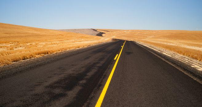 Open Road Two Lane Highway Oregon Landscape Harvested Farmland