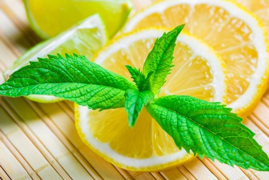 beautiful macro shot of lemon and mint leaves