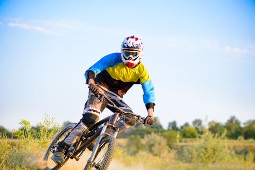 Cyclist Riding the Mountain Bike on the Trail