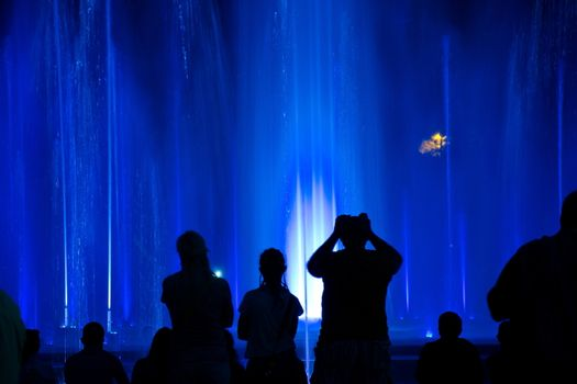 People wondering colourful fountain in Budapest, Hungary