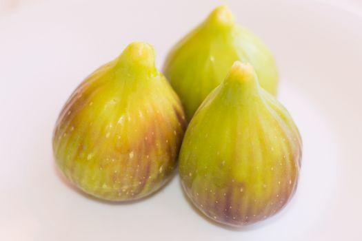 Three figs on white