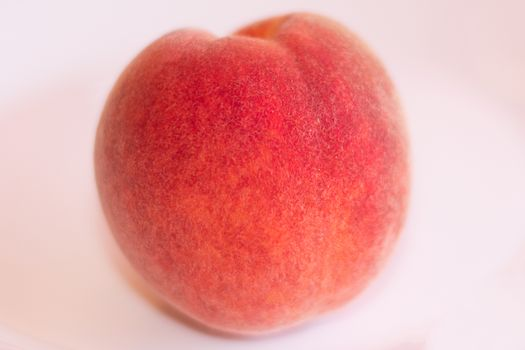 One peach on white