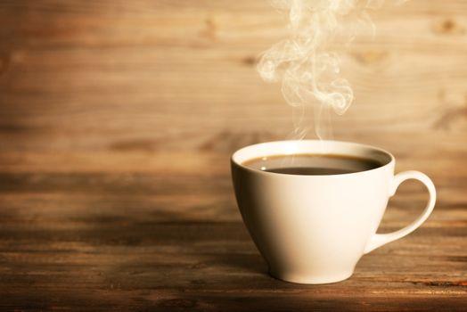 Steaming coffee in white mug