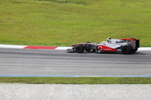 SEPANG, MALAYSIA - APRIL 04 : Vodafone McLaren Mercedes driver Lewis Hamilton of Great Britain drives during at the Sepang F1 circuit April 04, 2010 in Sepang.