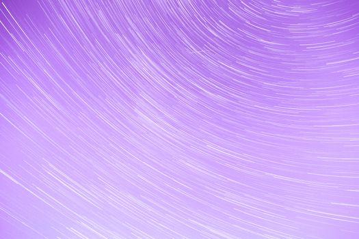 Star Trails streaking across a Purple Sky.