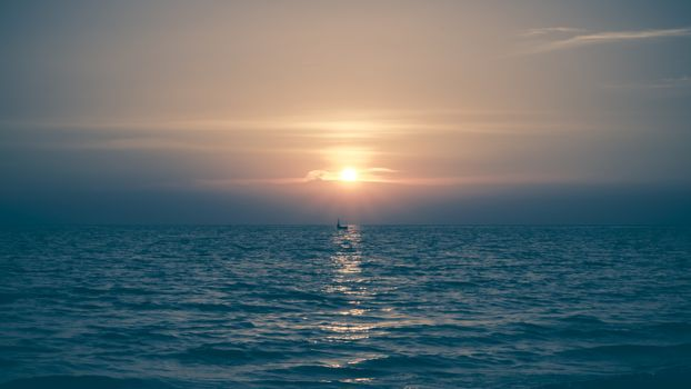 Yellow Sun Set in The Middle of The Ocean blurry vintage style