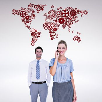 Composite image of businesswoman having phone call while her colleague posing