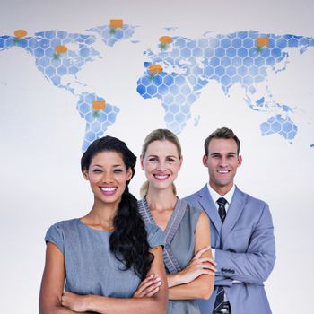 Composite image of happy business team smiling at camera