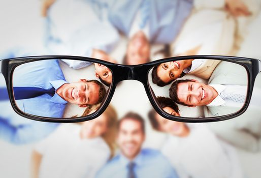 Composite image of young business people lying in circle
