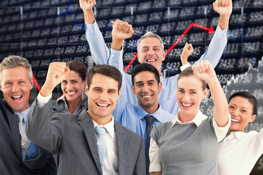 Composite image of business people cheering in office