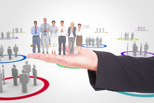 Composite image of smiling business people applauding