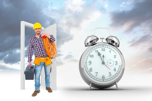 Composite image of handyman holding tool box and multimeter
