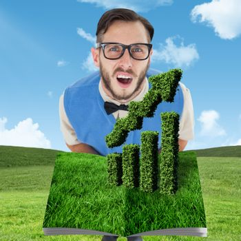 Man holding lawn book against blue sky over green field