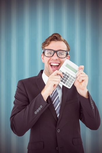 Geeky businessman pointing to calculator  against blue background
