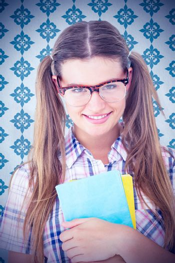Geeky hipster smiling at camera  against blue background