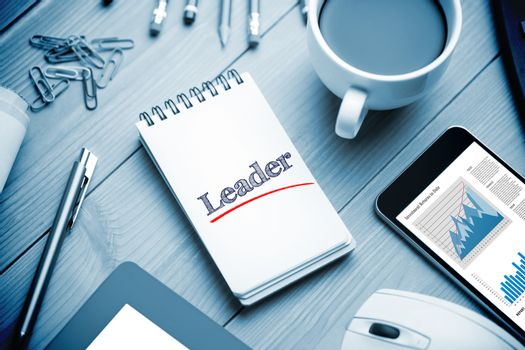 Leader against notepad on desk