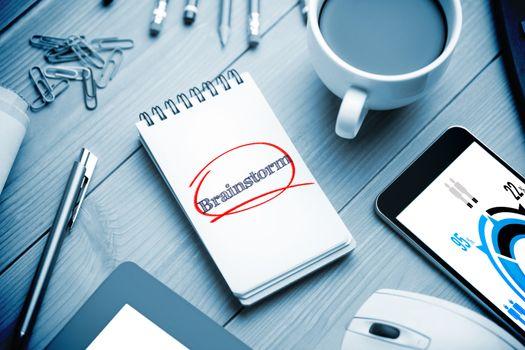 Brainstorm against notepad on desk