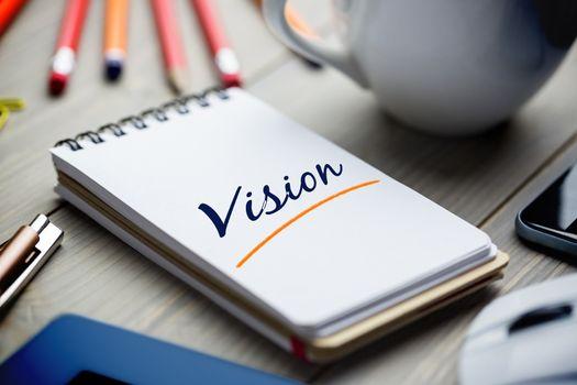 Vision  against notepad on desk