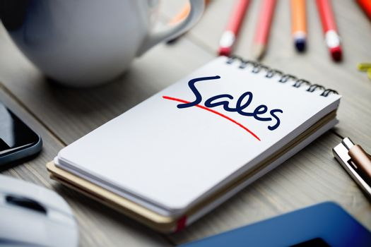 Sales against notepad on desk