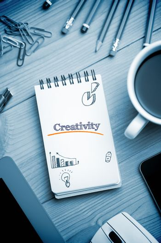 Creativity  against notepad on desk