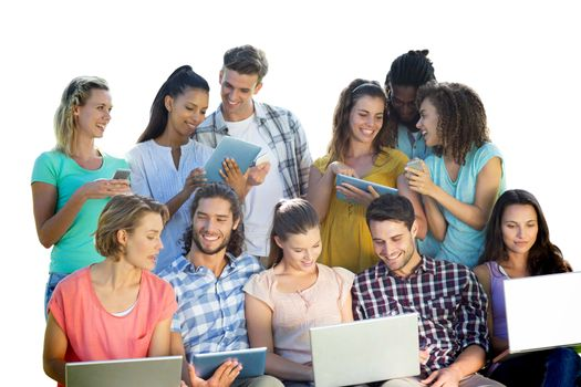 Composite image of several students using electronic devices