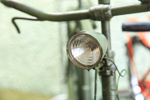 Close up detailed view of  headlights on vintage bicycle handle bar.