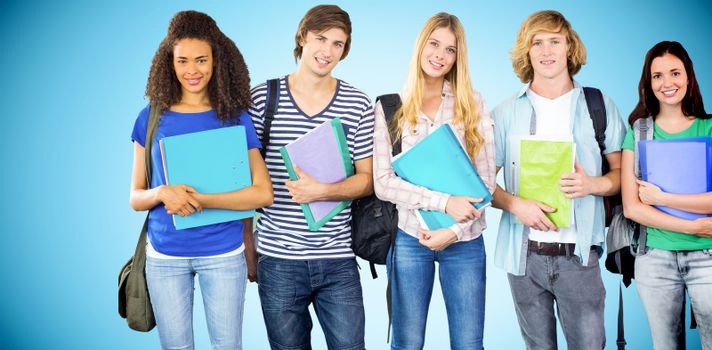 Happy college students holding folders against blue background with vignette