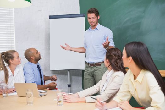 Businessman giving presentation to co workers