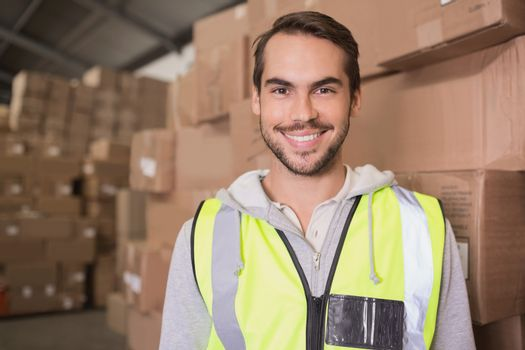 Smiling manual worker in warehouse
