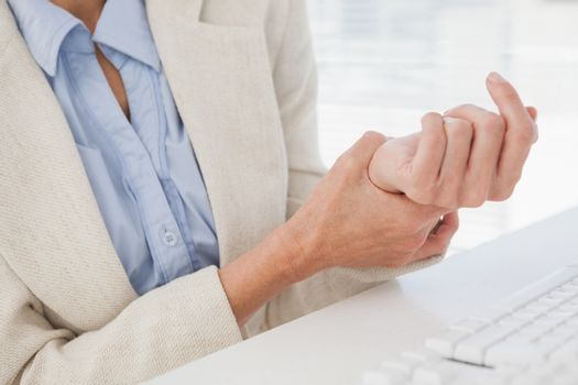 Woman massaging her sore wrist