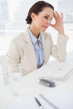 Woman massaging her sore head