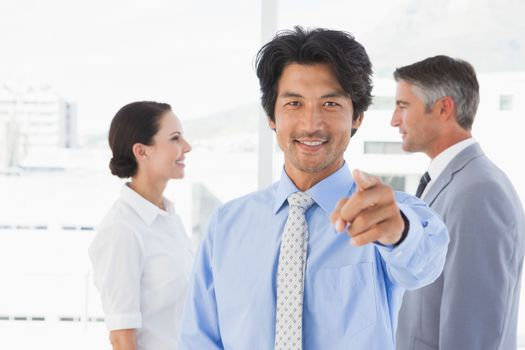 Businessman pointing to the camera