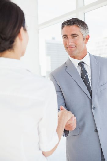 Businessman shaking co workers hand