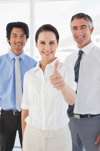Smiling businesswoman giving a thumbs up