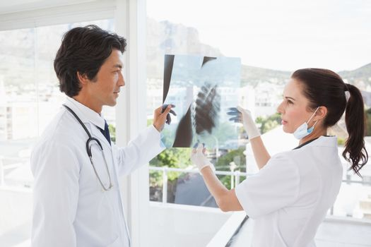 Doctors both looking over an x ray