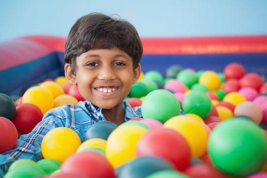 Cute boy smiling in ball pool