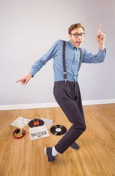 Geeky hipster dancing to vinyl