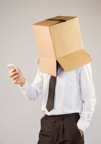 Anonymous businessman with his smartphone