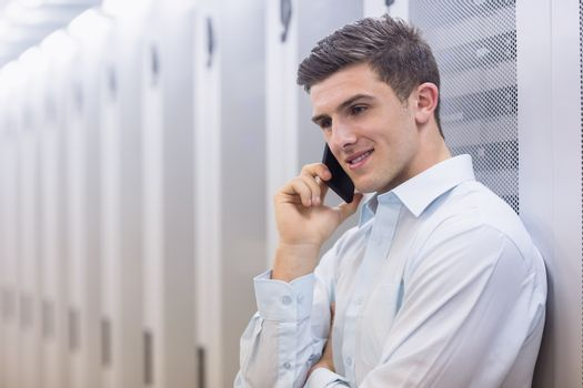 Smiling technician on the phone